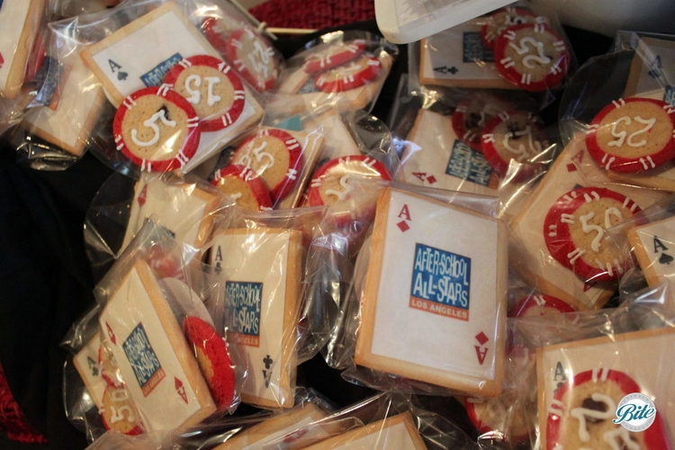 Branded cookies for corporate event. Card and poker chip themed cookies in packaging as party favors