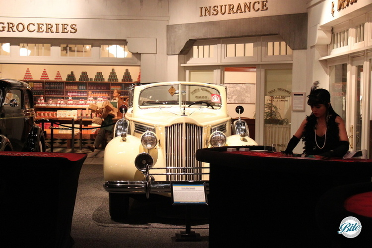 Casino themed entertainment station with vintage car in background