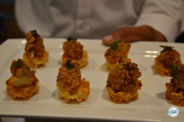 Waffles with Buttermilk fried chicken, smoked paprika, maple syrup and herb garnish. Tray passed at a bridal shower