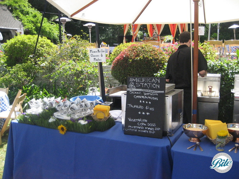 Action station featuring cheeseburgers, fries, and corndogs @ backyard wedding in Bel Air