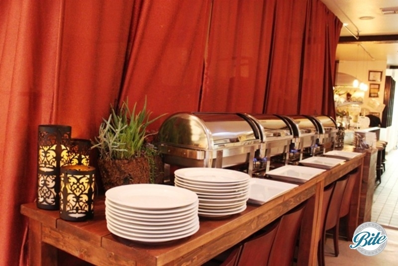 Buffet dinner display with succulents, candles, draping on long wood tables