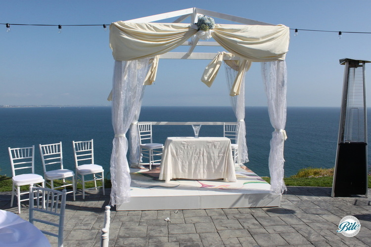 Beautiful views at this Malibu wedding ceremony in the backyard of a lovely home overlooking the ocean.
