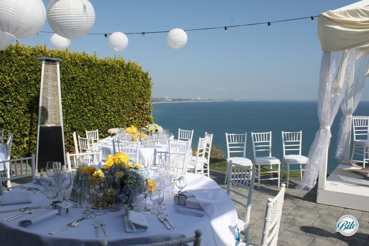 Tables and overhead lamps led to a beautiful view by day and enchanting setting at night.