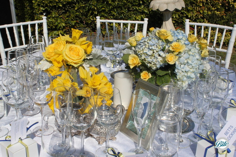 Backyard wedding table set for reception with ocean view