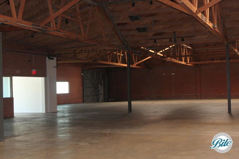 Building has open floor plan and rafters
